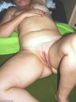 Wife's spread and cum filled pussy